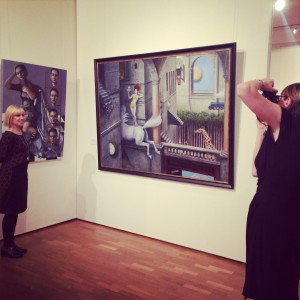Wendy Bills being photographed with her artwork