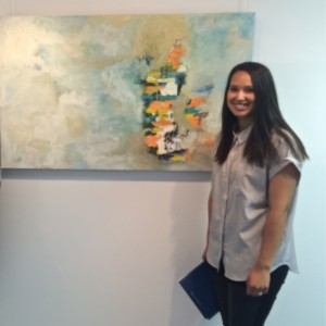 Emerging Artist Stacey Coralde with one of her artworks