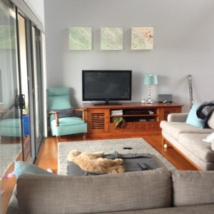 An in-situ photograph taken by a recent client who purchased three 45x45cm Beach Studies by Sally West